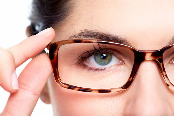 bigstock-Eyeglasses-Woman-wearing-eyeg-53013055