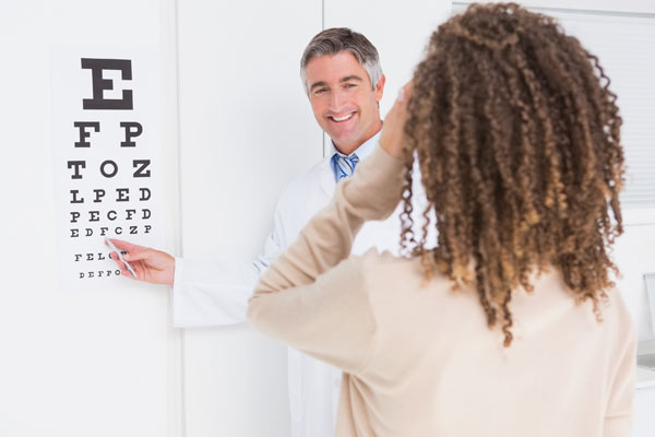 bigstock-Woman-doing-eye-test-with-opto-85061228